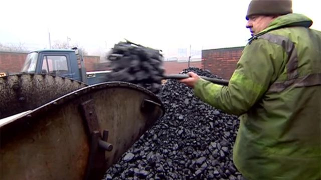 Man loading coal