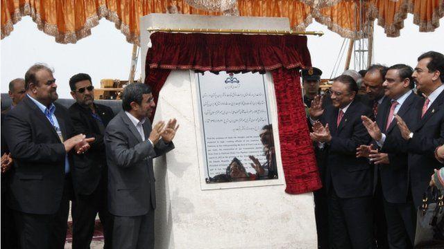 Iran's Mahmoud Ahmadinejad and President Asif Ali Zardari of Pakistan unveil plaque at pipeline inauguration