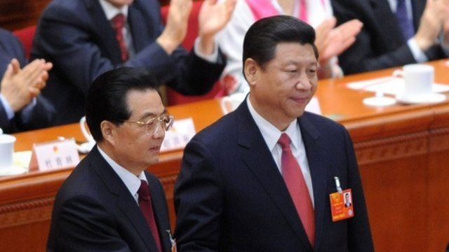 Chinese President Xi Jinping (R) with former president Hu Jintao (L)