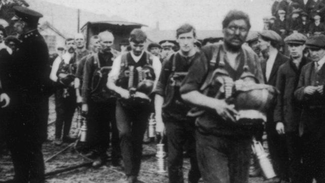 Rescue party returns from its search for survivors at the Universal Colliery disaster in Senghenydd in 1913