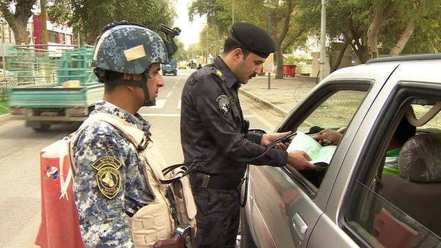 Iraqi security guards checking papers