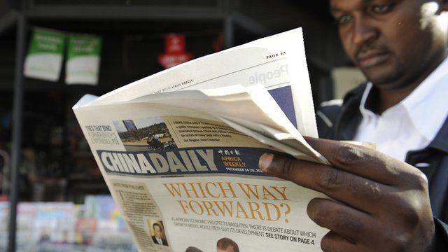 A man in Kenya reading a newspaper