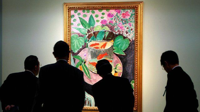 Japanese visitors look at the Gold Fish, a 1912 masterpiece by French painter Henri Matisse, during a preview of the exhibition 'Masterworks of French Impressionism and Modernism