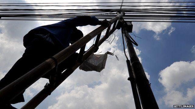 Man repairing electrical network in Jakarta