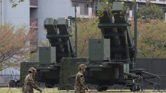 Members of the Japan Self-Defence Forces deploy Patriot Advanced Capability-3 (PAC-3) missiles at the Defence Ministry in Tokyo