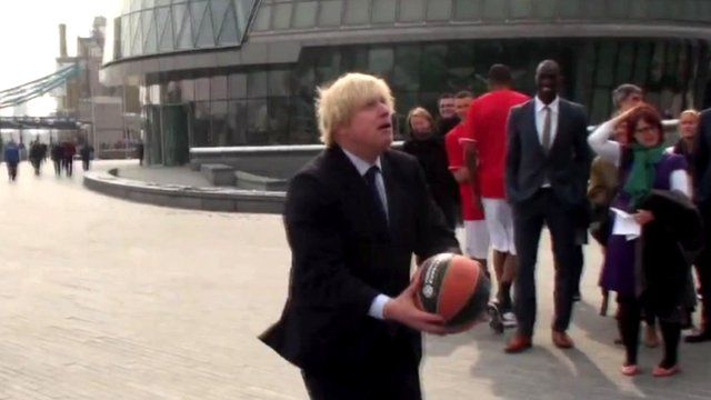 London Mayor Boris Johnson with a basketball
