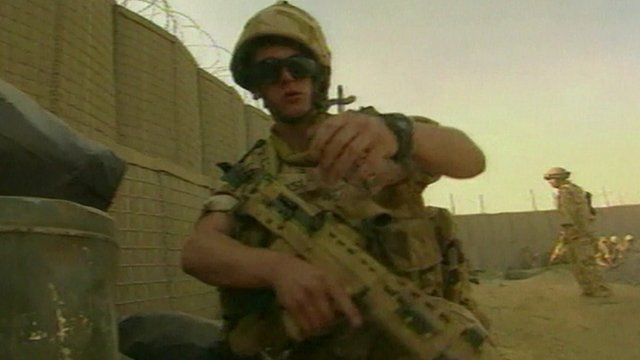 Soldier holds weapon