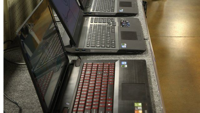 row of computers for sale in shop