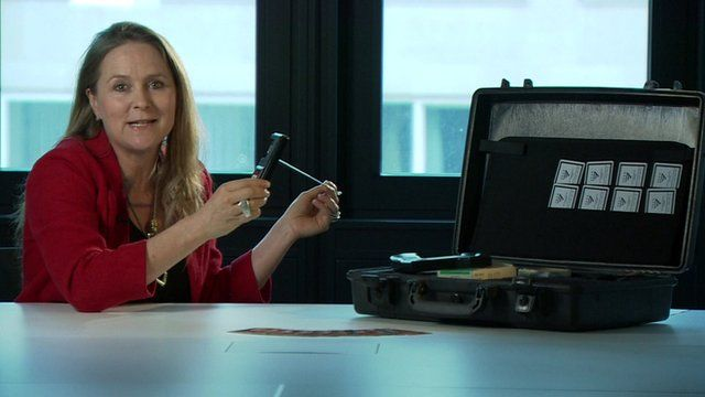 Caroline Hawley pictured holding a fake bomb detector