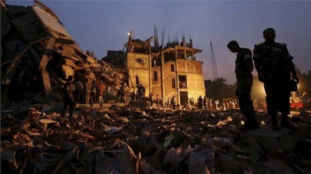 Bangladeshi soldiers stand in the rubble at the site of a building that collapsed in Savar, near Dhaka, Bangladesh