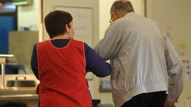 Elderly person and carer