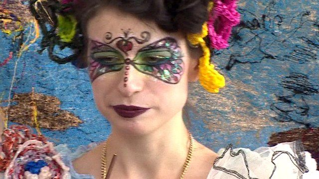 woman with painted face mask