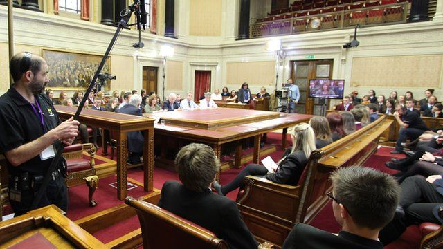 Students and MLAs in the Senate Chamber at Parliament Buildings, Stormont