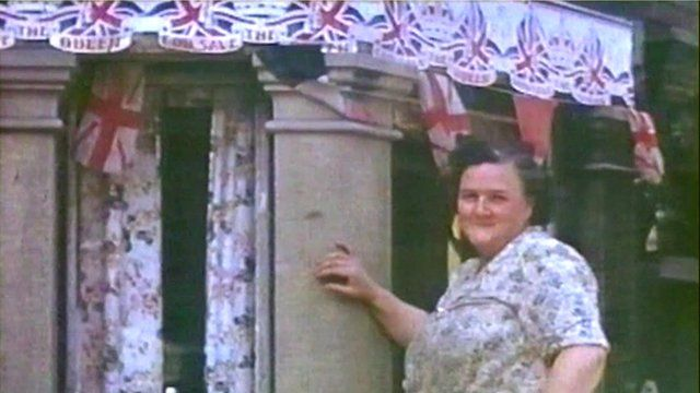 Woman decorates house with bunting