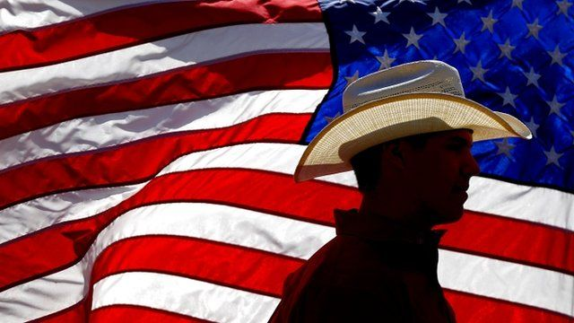 Man walks past US flag