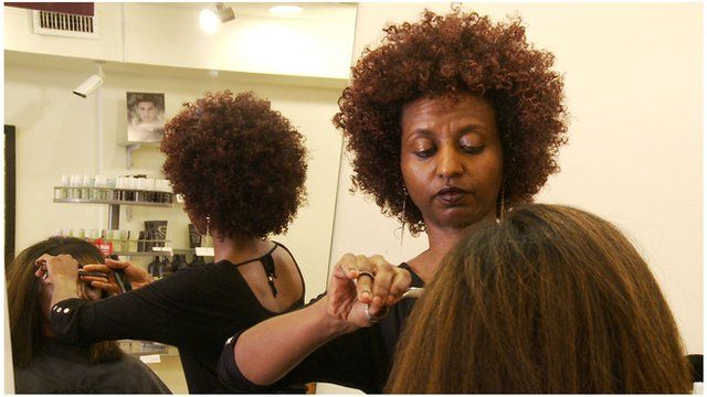 An Ethiopian immigrant hairdresser in a Washington salon
