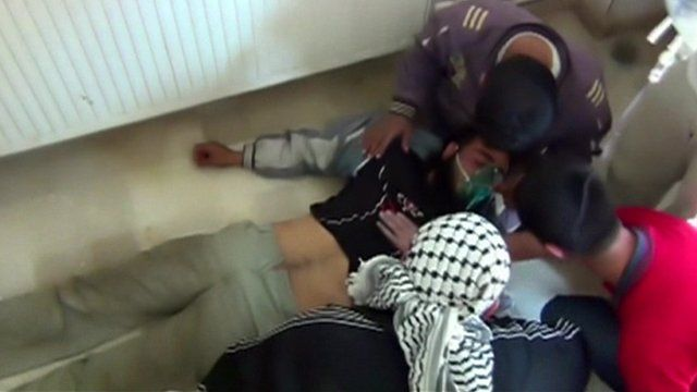Syrian activists treating colleague they say was a victim of a chemical weapon attack