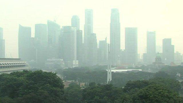 Wood-smoke cloud hangs over Singapore