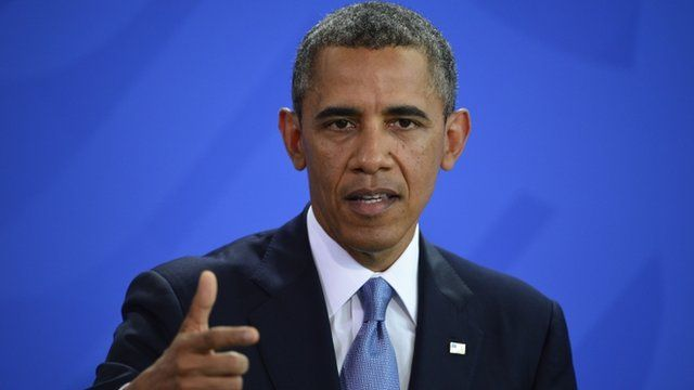 US President Barack Obama gestures during a joint press conference with German Chancellor on June 19, 201