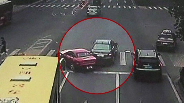 Security footage shows collision between two cars