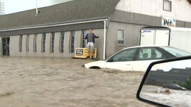 Man and cars surrounded by water in Canada