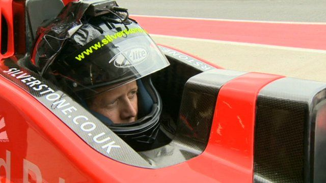 Mike Bushell in the rear seat of a two-seater F1 car
