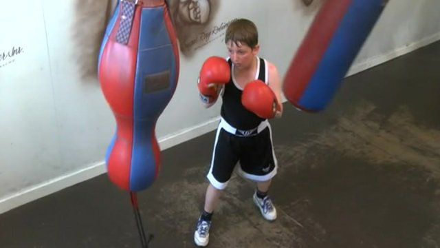Young boy boxing