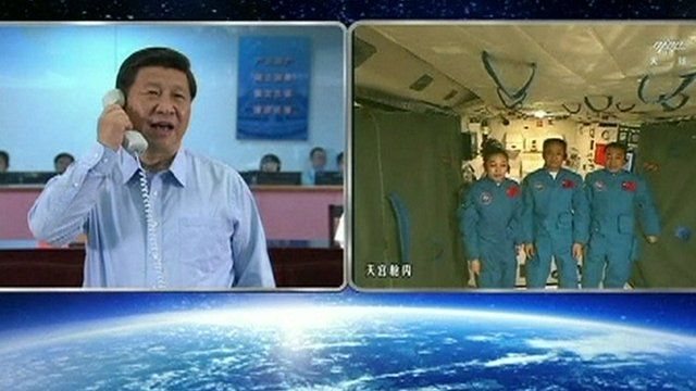 Xi Jinping speaking to astronauts