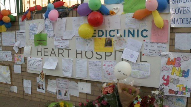 Messages and flowers left at the Pretoria hospital where Nelson Mandela is being treated