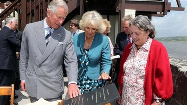 The Prince of Wales and Duchess of Cornwall outside the Boathouse, the home of poet Dylan Thomas