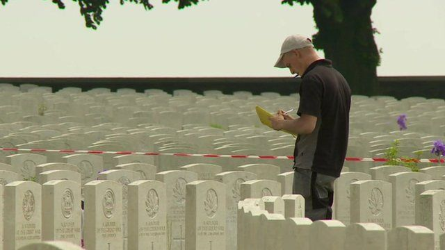 Man inspecting gravestones