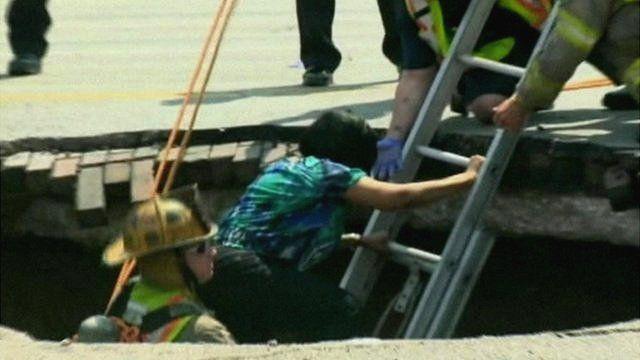 Woman escapes sinkhole