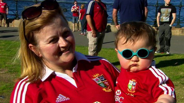 Woman with toddler in Lions kit
