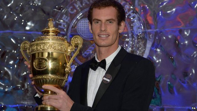 Andy Murray holds mens singles trophy