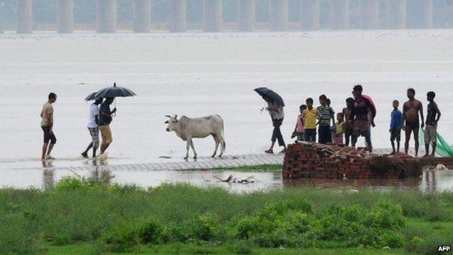 People on flooded road in Uttarakhand