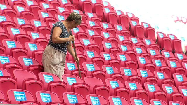 A woman cleans the Kazan stadium