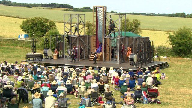 Actors perform onstage in Towton field