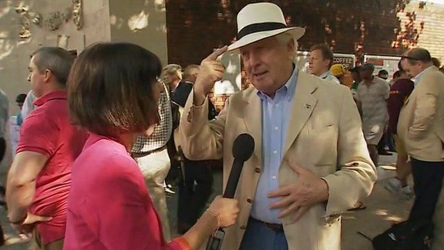 Spectator Bill points out his linen jacket and panama hat
