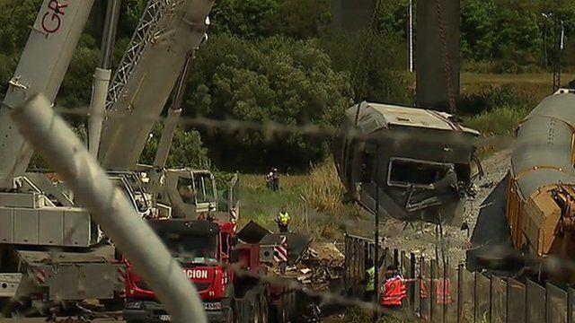 Crane lifting carriage off side of train tracks