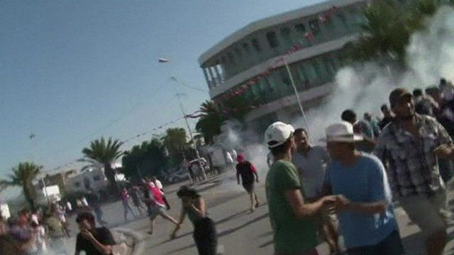 People flee tear gas in Tunis