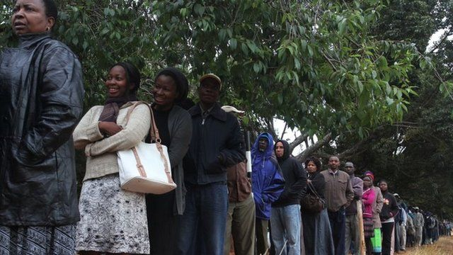 A queue of voters wait to cast their ballots as the country went to the polls in a Harare suburb Wednesday 31 July 2013