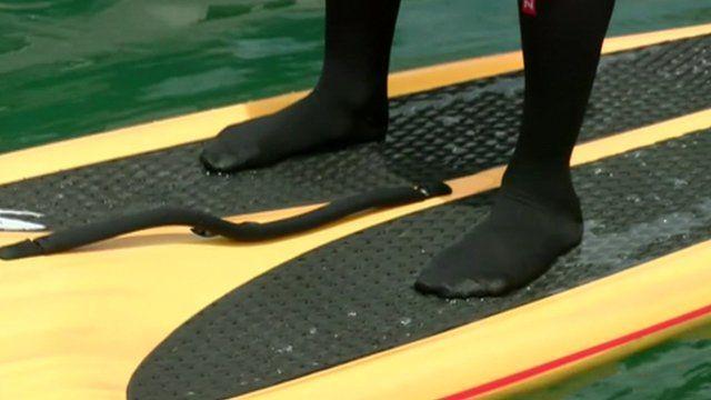 Feet on paddle board