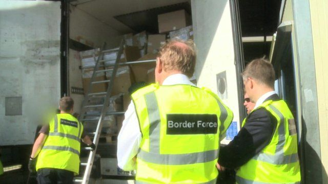 Border Force officials check a lorry