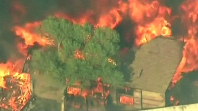 Aerial view of a house engulfed by fire