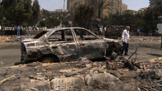 Burnt-out car at Rabaa al-Adawiya