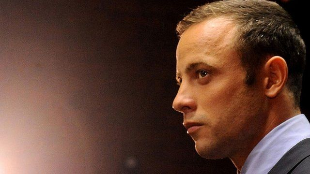 In this Friday, Feb. 22, 2013 file photo Olympic athlete Oscar Pistorius stands in the dock during his bail hearing at the magistrates court in Pretoria, South Africa