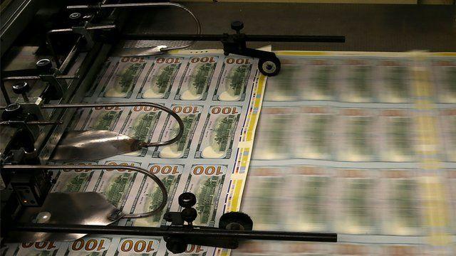 $100 bills being printed