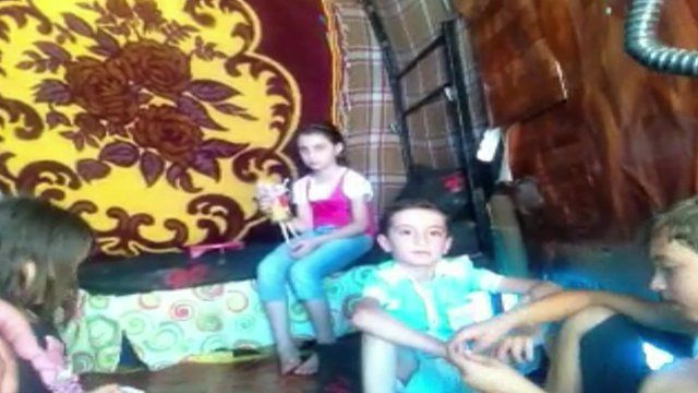 Mahmoud's family inside the container that it their home