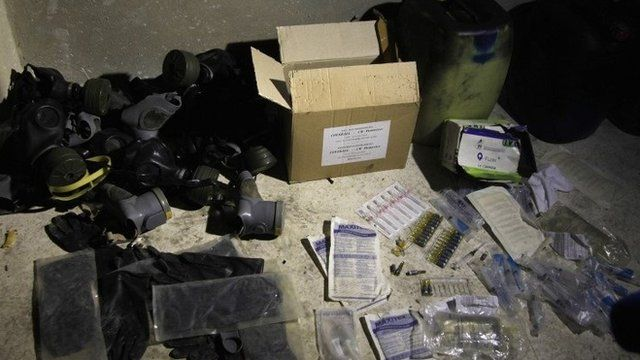 Chemical materials and gas masks purportedly found by Syrian government forces in the Damascus suburb of Jobar (24 August 2013)