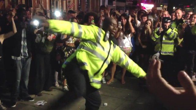 Police officer dancing at the Notting Hill Carnival